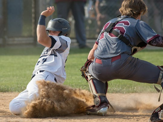 Dallstown's Tracy Carr beats the tag by Tyson Cooper