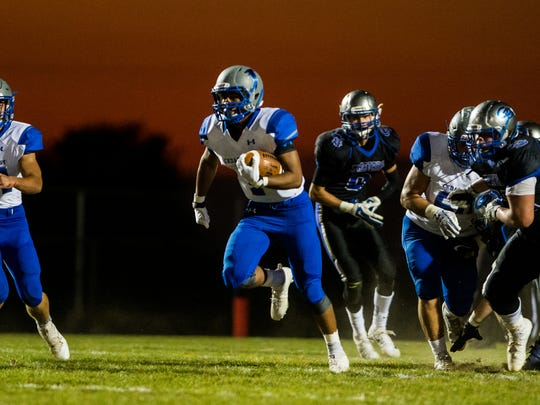 Cedar Crest's AJ Apple finds running room as Cedar Crest defeated Garden Spot 60-30 on Friday night. The Falcons host Cocalico in a key Section 2 battle this week.