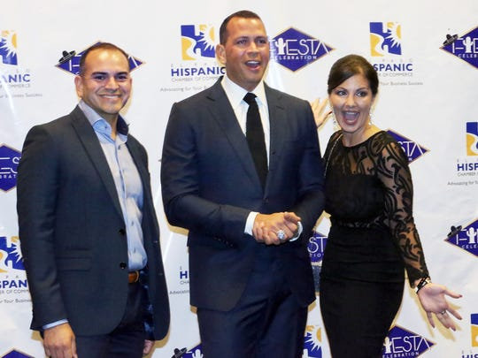 Alex Rodriguez, center, poses with Chris Chacon, left, and Melinda Ayoub at a reception before the start of the 27th Annual El Paso Hispanic Chamber of Commerce Fiesta Celebration Saturday.