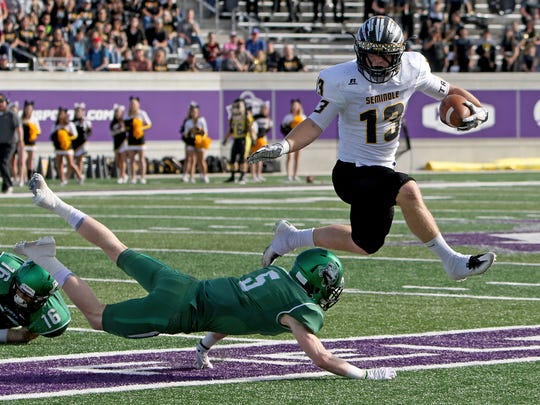 Seminole's Cade Bernard avoids a Iowa Park defender