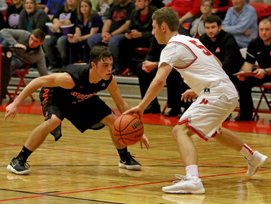 Nocona's Jeremy James guards Holliday's Noah Parker