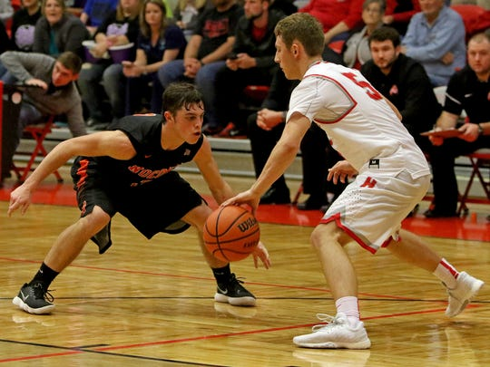 Holliday senior Noah Parker (right) was a four-year starter at point guard for Eagles and averaged 6.7 assists per game.