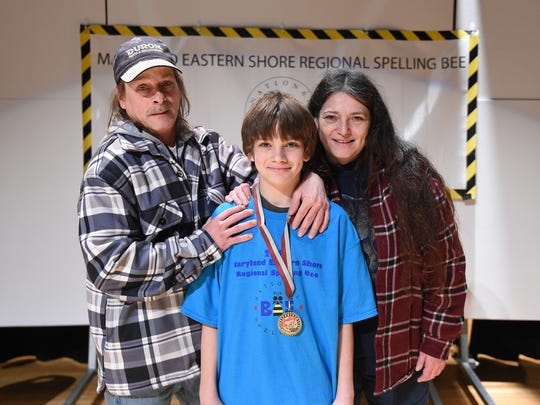 "James ""Jake"" Gordy of Princess Anne stands with his stepfather Walter Donophan and mother Lisa Adams after winning the Maryland Eastern Shore Regional Spelling Bee."