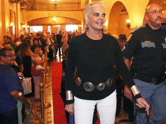 Ali MacGraw strolls along the red carpet as she enters