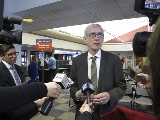 Wisconsin Gov. Tony Evers speaks to reporters Monday, March 25, 2019, in Madison, Wis. A Wisconsin appeals court has sided with Republicans on Wednesday, March 27, 2019, reinstating laws passed during a lame-duck legislative session that weaken powers of Gov. Evers and the attorney general.