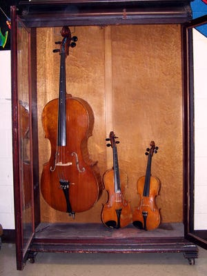 The Chatfield instruments and display case were donated to the Oconomowoc School District in 1937 by long-time city planner and luthier Frank Chatfield.