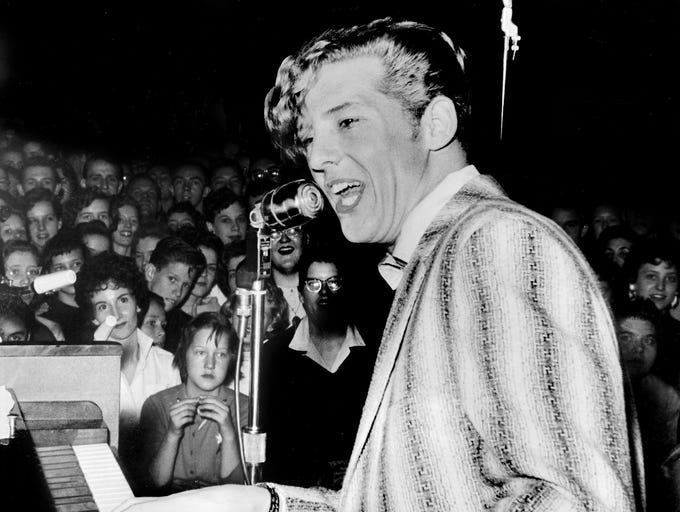 "Jerry Lee Lewis, young rock and roll prince, bellows there's a ""Whole Lot of Shakin' Goin' On,"" on Jan 18, 1958, during the Record Hop show at the Tennessee State Fairgrounds Coliseum in Nashville."