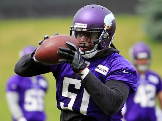 FILE - In this June 13, 2017, file photo, Minnesota Vikings linebacker Edmond Robinson makes a catch during NFL football practice, in Eden Prairie, Minn. With Chad Greenway retired, there's a rare opening in the lineup, with Emmanuel Lamur, Edmond Robinson and Ben Gedeon in the mix.(AP Photo/Andy Clayton-King)