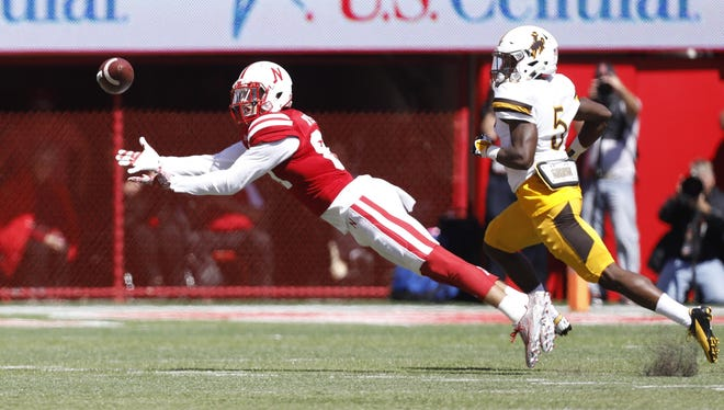 Nebraska Cornhuskers receiver Brandon Reilly stretches out to make a catch against Wyoming.