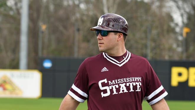 Mississippi State assistant coach Jake Gautreau watches from first base during the game against Southern Miss on Saturday at Pete Taylor Park.