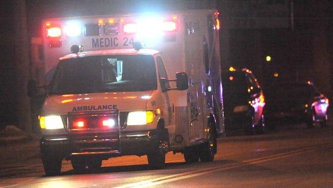 An ambulance responds to a crash.