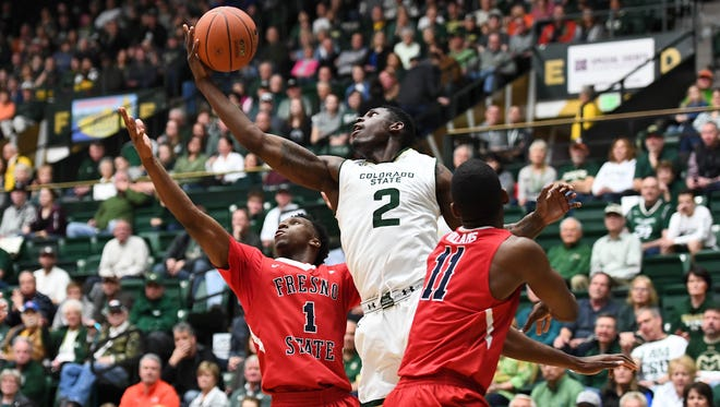 CSu's Emmanuel Omogbo fights for a rebound during Saturday's win over Fresno State at Moby Arena/.