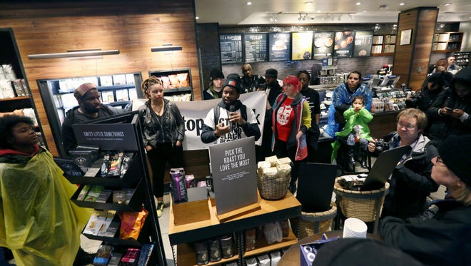 Demonstrators occupy the Starbucks that has become the center of protests on April 16, 2018, in Philadelphia.