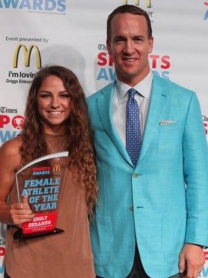 Evangel's Emily Deramus with Peyton Manning at Times Sports Awards.