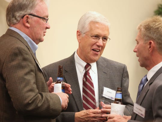 Al Rent (center), director of Relationship Marketing and Community Relations at Ball State University, talks with Kelly Stanley (left), chairman of the BMH Foundation, and Hank Milius, president of Meridian Services, during the 2010 United Way Leadership Giving Reception at the Whitinger and Company building on Wednesday, Oct. 6. Donors were thanked at the reception for their contributions and updated on United Way's fundraising efforts.  The organization hopes to raise $2.2 million this year.