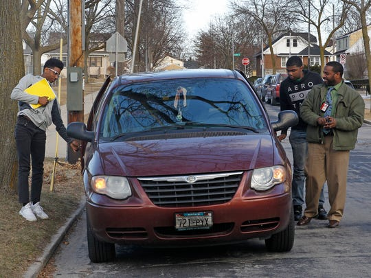 Fred Gayle (right) drops his sons, Austin (left), 15, and Jason off for driver's education  in Milwaukee. Fred and his wife, Soncera, can't seem to find the time to balance their health and wellness because they spend an enormous amount of time shuttling their three children to baseball, basketball, soccer and music lessons.
