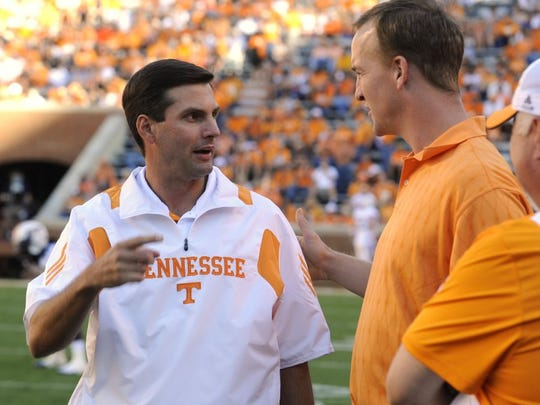 Tennessee coach Derek Dooley talks with Peyton Manning before the UT-Martin game Sept. 4, 2010, in Neyland Stadium.