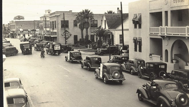 Looking north on Chaparral at the intersection with Taylor Street on Dec. 16, 1935, shows the Vaky Court Apartments, the Royall Givens' house, and the Railway Express Agency office. The Givens' residence was once known as the Ironclad Oath House after the Civil War. Photo by Doc McGregor.