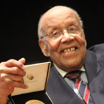 Fred Johnson, a Tuskegee Airman, holds the Congressional