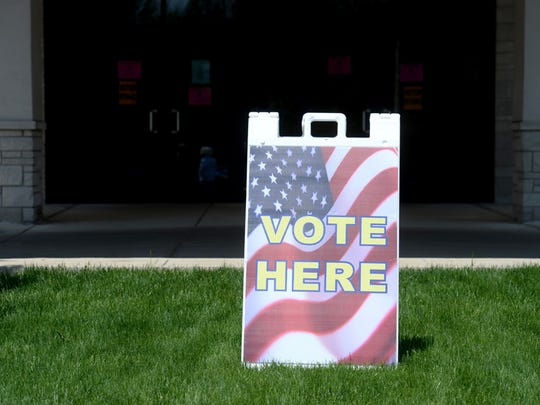 A sign alers voters where to go, Tuesday, May 5, 2015