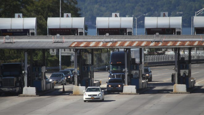 Cars go through the toll booths in Tarrytown after crossing the Tappan Zee Bridge Sept. 23, 2015.