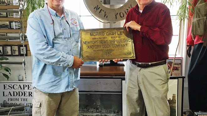 Jim Vogel, left, executive director of the NJ Maritime Museum, Beach Haven, accepts the builders plaque of the SS Morro Castle from Jerry Beer of the Bayville Historical Society. The artifact will be on display in the Morro Castle Room in the museum on Dock Road in Beach Haven.
