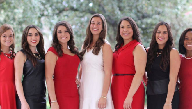 Madeleine Claire Ortte, 2014 Homecoming Queen for the University of Louisiana at Lafayette, center, and her court will reign over Homecoming activities when the Louisiana Ragin' Cajuns take on the South Alabama Jaguars on Nov. 1. Shown, from left, are: Anna Katherine Devitt of Baton Rouge, La.; Melanie Calyn Benit of Meraux, La.; Kristen Michele Ashford of Port Allen, La.; Madeleine Claire Ortte of Thibodaux, La.; Alexandra Dardar of Abbeville, La.; Paola Mercedes Doria of Houma, La.; and Hallie Renee' Boudreaux of Lafayette.