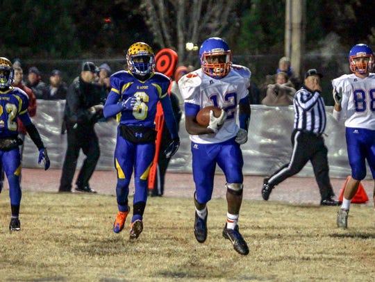 Delmar junior Te'Shawn Dennard outruns the A.I. du Pont defense for one of his eight touchdowns in a 56-21 semifinal victory last Friday.