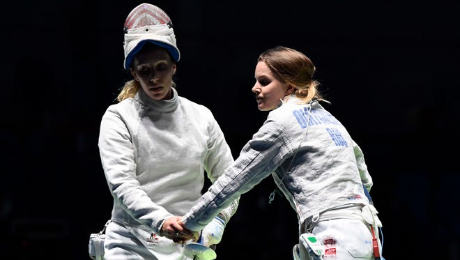 Mariel Zagunis (USA) faces off against Ekaterina Dyachenko (RUS) during the women's sabre individual competition in the Rio 2016 Summer Olympic Games at Carioca Arena 3 on Aug. 8.