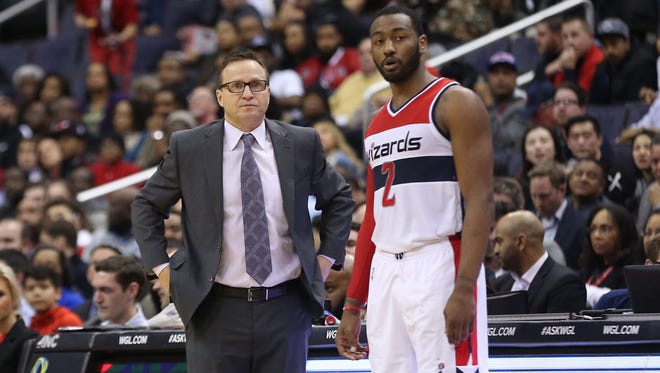 Washington Wizards guard John Wall (2) talks with Wizards head coach Scott Brooks against the Chicago Bulls in the fourth quarter at Verizon Center.