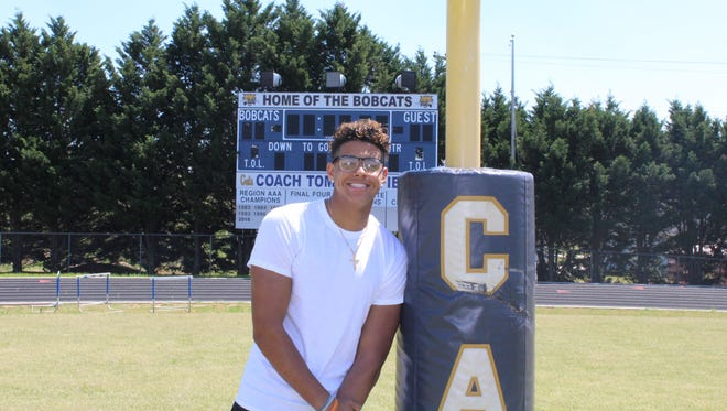 Braden Galloway poses for a photo at Seneca High School on Monday. Galloway, a junior at Seneca, committed to play football at Clemson on Saturday.