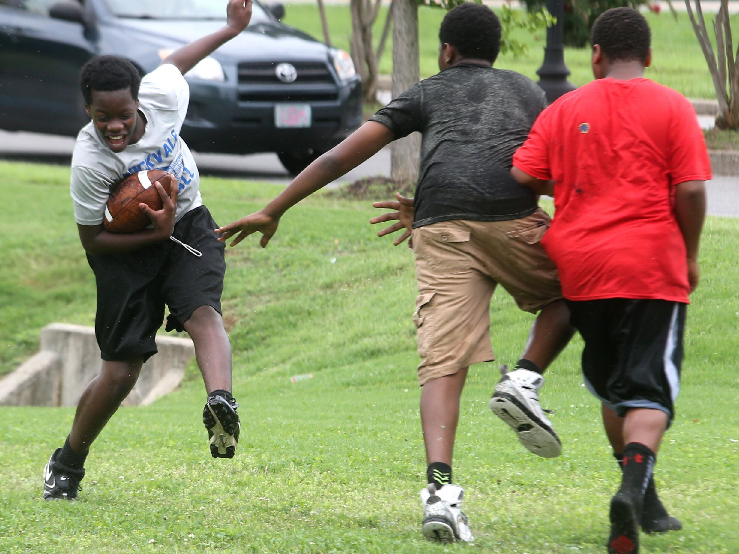 Rockvale's Damarcus Smalls, 13, tries to miss an opponent during Thursday's 7-on-7 contest at Patterson Park Community Center.