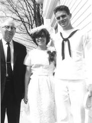 Tom Mooney, right, and his wife, Donna, were married