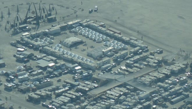 From its humble beginnings on a California beach, Burning Man has grown into a weeklong event in which participants create a temporary city in the Nevada desert. While most people camp in tents, a small number stay in luxury camps like this one, with air conditioning, flush toilets and professionally prepared meals, while sleeping in behemoth RVs and assisted by paid staff.
