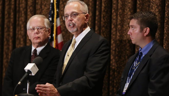 Lake County Coroner Dr. Thomas Rudd, left, Lake County Major Crime Task Force Cmdr. George Filenko, center, and Lake County sheriff's Detective Chris Covelli confirm that Fox Lake Lt. Charles Joseph Gliniewicz, 52, died Sept. 1 of a self-inflicted gunshot wound, during a press conference Wednesday, Nov. 4, 2015, in Round Lake Beach, Il. Gliniewicz carefully staged his death to make it look like he was killed in the line of duty and had been stealing for years from a youth program he oversaw, authorities said Wednesday.