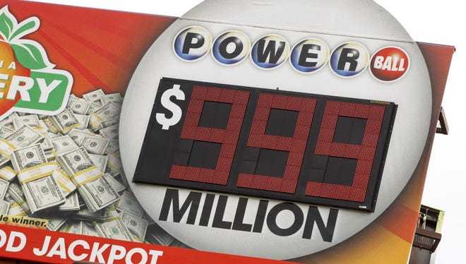 A sign in Decatur, Georgia, advertises the Powerball jackpot on Jan. 10. A group of Wilmington workers won $1 million in the drawing.