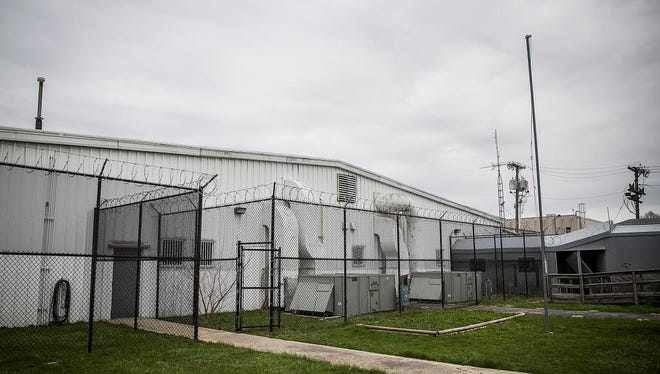 The large outdoor area of the future site of Muncie's animal shelter will be accessible full-time for cats in the shelter. Razor wire remains on the top of the fence from when the building was being used as a juvenile detention center.