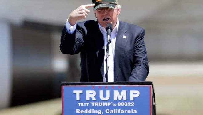 In this June 3, 2016 file photo, Republican presidential candidate Donald Trump appears at a campaign rally in Redding, Calif.
