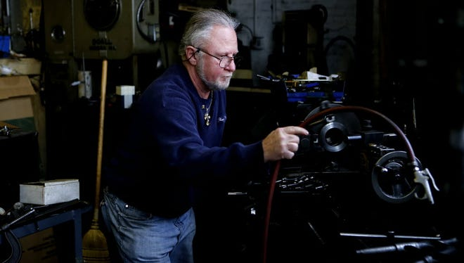 Ron Loos, owner of Quality Tool & Die in West Allis, works with a lathe earlier this year at his shop. The Labor Department said Friday that its Producer Price Index, which measures cost pressures before they reach the consumer, fell in July.