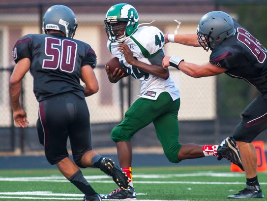 Parkside running back Nayel Oge (44) fights off a tackle