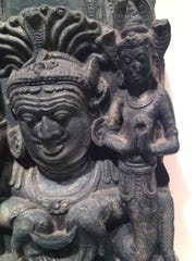 This closeup of a 10th century Hindu temple sculpture panel show, left, Rahu trying to eat the moon, which of course will slip from him because he has no body, and on the right Ketu, the Comet.