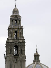 A man stands on a balcony in the California Tower at Balboa Park in San Diego. Originally built to host the 1915 Panama-California Exposition, the tower opened to public tours Jan. 1 for the first time since 1935.