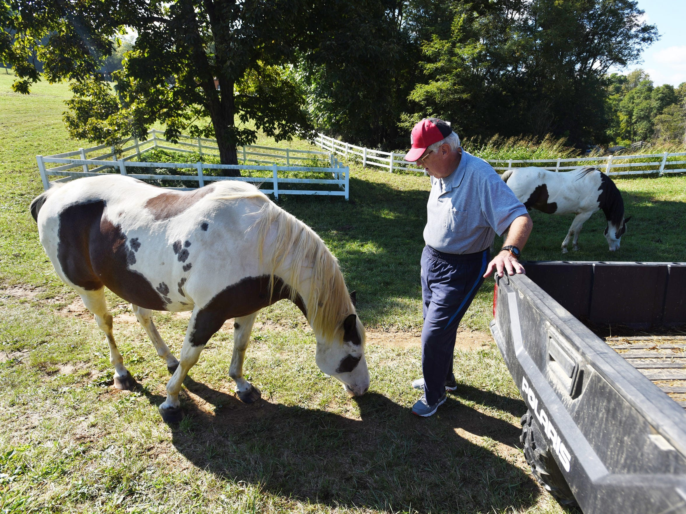 Sam Kopchak visits with his horse Red on his farm near