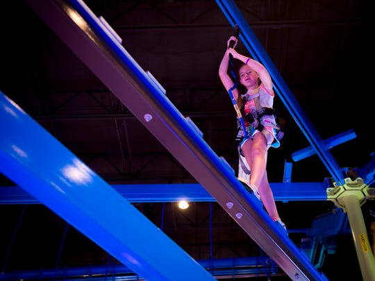 Children work through the gravity ropes course at Main Event Entertainment, which is now open at 9081 Kingston Pike.