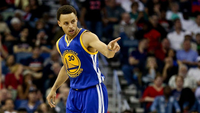Golden State Warriors guard Stephen Curry (30) reacts against the New Orleans Pelicans during the second quarter of a game at the Smoothie King Center.