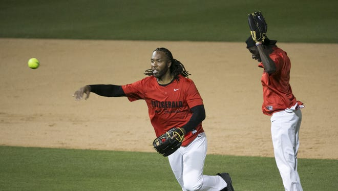Cardinals Larry Fitzgerald makes a double play against the White team during the Larry Fitzgerald Double Play Celebrity Softball Game at Salt River Fields in Scottsdale, Ariz. on April 22, 2017.