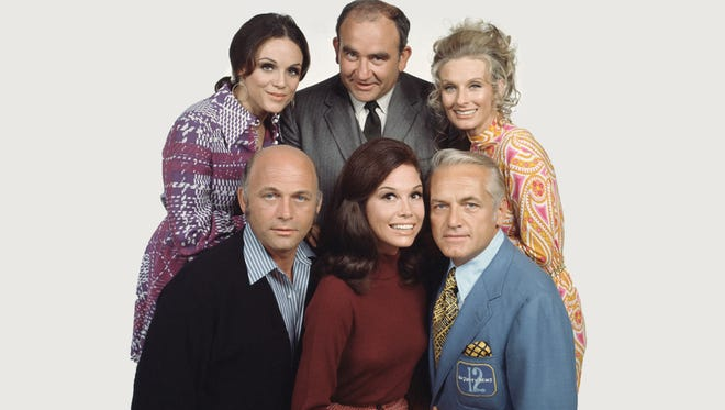 """Mary Tyler Moore (center) starred in the """"The Mary Tyler Moore Show"""" with (clockwise from left) Gavin MacLeod, Valerie Harper, Ed Asner, Cloris Leachman and Ted Knight."""