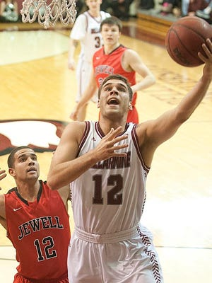 Bellarmine Knights forward Jake Thelen goes up for a basket as William Jewell Cardinals guard Jordan Lewis defends. Thelen had a team-high 29 points. Bellarmine defeated William Jewell, 70-50.04 January 2015