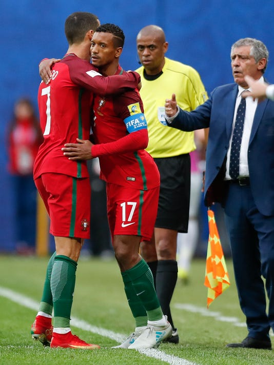 Portugal's Cristiano Ronaldo, left, is replaced by Nani during the Confederations Cup, Group A soccer match between New Zealand and Portugal, at the St. Petersburg Stadium, Russia, Saturday, June 24, 2017. (AP Photo/Pavel Golovkin)