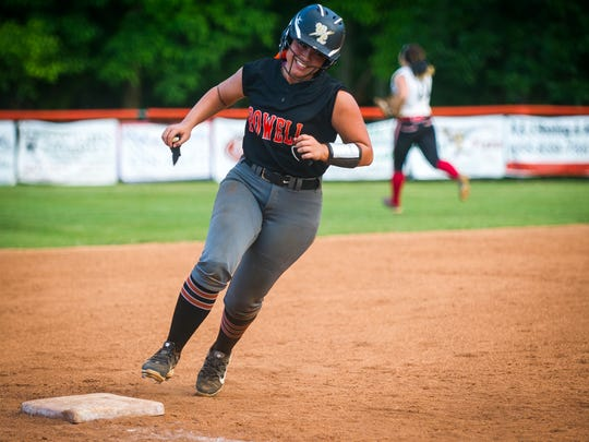 Powell's Kiley Longmire (6) smiles as she rounds third base to score during Powell's and Cherokee's Class AAA game in Powell on Friday, May 19, 2017.